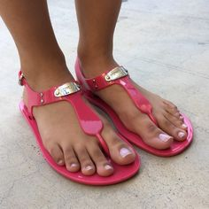 Pink MICHAEL by Michael Kors Jelly Sandals Pink Michael Kors Jellies perfect for Summertime or anytime , Pair with almost anything ... Crops shorts or a pretty sundress comfortable , cute, and feminine  minimal wear to the sole , some scuffing on the logo plate & some slight discoloration on the strap (shown in pic#2&3) MICHAEL Michael Kors Shoes Sandals