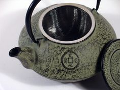 Cast iron teapot - grey/green chinese coin design :: chinalife