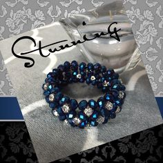 Stunning Beaded Bracelet - Gorgeous Color  This bracelet is beyond fabulous!! Iridescent blue beads and clear rhinestones set in silver make it sparkle for days! Nice & heavy, but not too heavy with elastic that makes it bracelet glide onto your hand...perfect addition to anyone's jewelry box  BOGO 1/2 OFF SALE GOING ON NOW!  Jewelry Bracelets