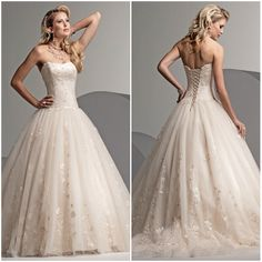 Lace-up wedding dress with gold accents.