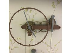 This is a remix of the super Bullzeye Clock by Zarlor. I have re-designed it to be 1.5 times larger and added a ratchet on the string pulley for easy winding. My clock runs for about 8 hours and uses a 1.7Kg weight. I used lead shot. All the steel rods are 2mm the four main ones for the gears are 43mm long. The rod in the string gear is glued into the gear. The other three gear assemblies spin freely on their rods. The rods for the pendulum and the hands are sized to suit. I used 15mm x 3mm…