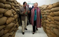 U.S. Secretary of State Hillary Rodham Clinton, right, talks with Agribusiness Advisor Bency Isaac, left, as she tours the Timor Coffee Cooperative in Dili, East Timor Thursday, Sept. 6, 2012. (AP Photo/Jim Watson, Pool) ▼6Sep2012AP|Clinton in East Timor on democracy push http://bigstory.ap.org/article/clinton-east-timor-democracy-push #Dili #East_Timor #Timor_Lorosae #Hillary_Clinton