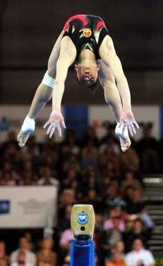 She is probably going to miss putting her hands on the beam and do a full on belly flop/face plant/split the beam