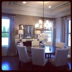 In the dining room, the furniture is all neutral, leaving the ...
