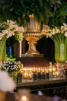 Beautiful calla lilies to complement the over sized foliage and accent candles | Chocolate Rain forest | White Lilac Inc. | Event Design for Weddings, Fashion, Social and Corporate functions.