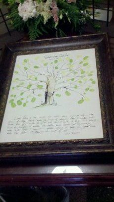 Wedding reception fingerprint tree.  Make sure that you also have wet ones to remove the ink off of your guests fingers and a wastebasket nearby.