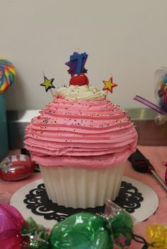 Cute cupcake cake at a Candy party!   See more party ideas at CatchMyParty.com!  #partyideas #candy