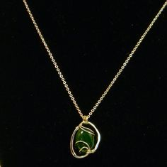 This is sculpted wire pendant with a 10mm x 14mm malachite cabochon. It is my first practice piece that actually looks at about 90% of what I want a finished one to look like. The wire is silver plated and similar pendants would start at $35.