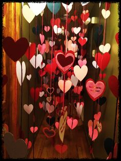 Hearts hung in the hallway as a Valentine's morning wake up surprise. Hearts filled with love messages like: You are my sunshine, you are the best gift ever, I love you, I am the luckiest mommy in the world, Best.Kid.Ever!, best gift ever, you are the cutest thing ever, xoxo, Happy Valentine's Day, etc.
