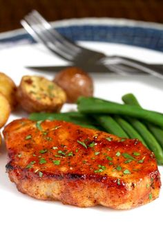 These Oven Baked Pork Chops are seasoned with simple spices and then baked to perfection. This baked pork chop recipe produces succulent, tender, juicy and flavorful pork chops every time! This baked pork chop recipe Oven Roasted Pork Chops, Best Baked Pork Chops, Boneless Pork Loin Chops, Roasted Potatoes, Pork Loin Ribeye Chops Recipe, Pork Chops In Oven, Easy Pork Chop Recipes, Pork Recipes, Cooking Recipes