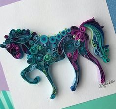 Unicorn made from mini rolls of coloured paper