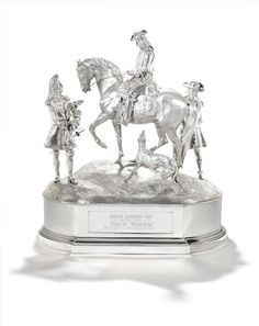 A monumental Victorian silver figural table centre piece and plinth by Robert Garrard (II), London 1840, the plinth also by Robert Garrard (II) London 1844.Formed as The Duke of Marlborough taking the surrender at the Battle of Malplaquet from Villiars in 1709, the Duke on horseback with Villiars standing, his gauntlet discarded to one side, behind the horse another figure (possibly Prince Eugene of Savoy), all standing on a naturalistic grassy bank