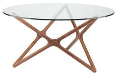 The Star dining table by Nuevo Living will bring a sophisticated modern look to any space at an affordable price. Available in walnut stained ash in two sizes. Features: - Glass Top - Walnut Dimension