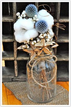 Cotton adds an interesting texture to this flower arrangement - would look cute on a couple of tables.