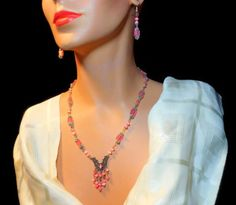 Pink fiber optic glass and upcycled beads with vintage festoon beadwork necklace and dangle hook earrings in silver plate