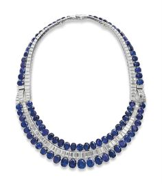 On sale November 15th at Christie's in Geneva  a_sapphire_synthetic_sapphire_and_diamond_bib_necklace_by_van_cleef_ar_d6029582g