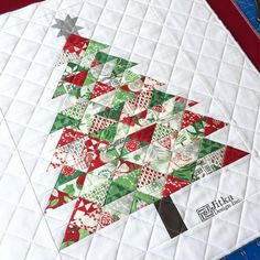 paper-pieced & quilted Christmas tree pillow | from Jitka Designs via IG | pattern here ($9): https://www.craftsy.com/quilting/patterns/christmas-tree-paper-pieced/466307