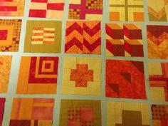Tula Pink modern sampler blocks in shades of orange.