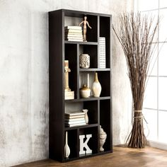 Clean up your home and save space with cappuccino satin finished wood veneer three-in-one display cabinet, TV stand, and bookcase. This modern piece of furniture has nine compartments that vary in width/length and measures a total of 71 x 31 x 11 inches.