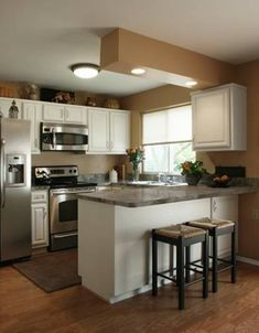Great Small Kitchen Design With Small Dark Tiles Countertops Two Bar Stools Also Modern Kitchen Cabinet With Chrome Oven Plus Electric Kitchen Stove As Modern Kitchen Furnitures Interior Design
