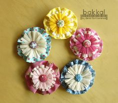 Fabric and felt yoyo.  Love these.  Would be cute on headband or brooches.