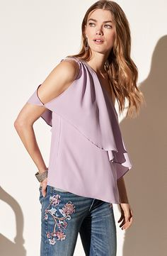If you have to choose one blouse, make sure it's our one-shoulder silhouette done the prettiest purple and polished off with a feminine ruffled overlay. It's perfect match is our Floral Embroidered Straight Crop Jeans. WHBM | Petites