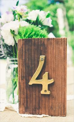 DIY table numbers with stained wood piece and house number. Captured By: Three Little Birds Photography ---> http://www.weddingchicks.com/2014/05/12/northern-california-farm-wedding/