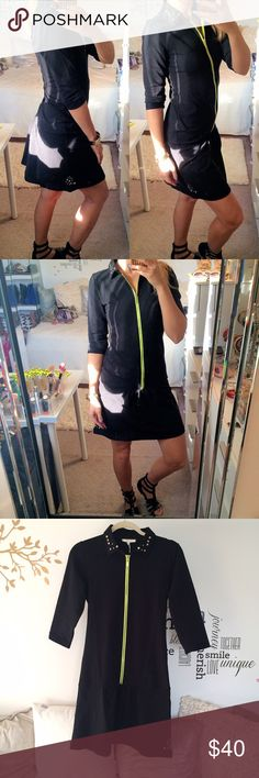Black Sporty Dress with Neon Zipper 👗 Brand-new with tags. Says size M but also good for S, I am S. Top to bottom measures approximately 35 inches. Studded detail at the collar and bottom left side. Half sleeve, very comfortable, stretches very well. I'm 5'7. Mery's Fashion Dresses