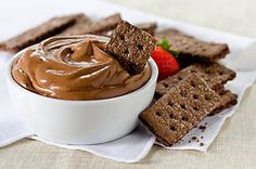 Chocolate graham crackers taste divine with melted chocolate and whipped topping—a blend that's part dip, part mousse and all delicious!