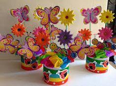 Resultado de imagen para centros de mesa infantiles de flores y mariposas