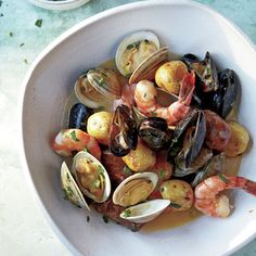 Sheet-Pan Clambake With Mussels, Shrimp, and Chorizo Recipe Main Dishes with smoked sausage, yukon gold, mussels, jumbo shrimp, unsalted butter, seafood seasoning, littleneck clams, flat leaf parsley