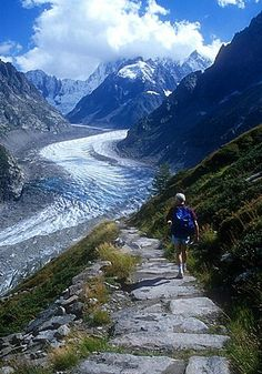 Hiker by the glacier, Mer de Glace, near Chamonix, Haute Savoie, France