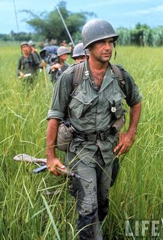 US Army Captain Robert Bacon leading a patrol during the early years of the Vietnam War, by Larry Burrows 1964. Vietnam War (V)