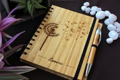 Dandelion - bamboo notebook- woodgeek- The petals of a dandelion are delicate and beautiful. Its beauty is ethereal and momentary. The evening breeze carries its beautiful petals to new places and the dandelion blooms and adds colour to another patch of soil.