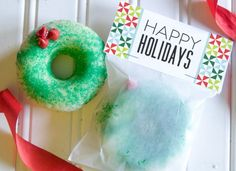 Make a simple donut wreath with sprinkles and red chocolate chips. | 41 Adorable Food Decorating Ideas For The Holidays