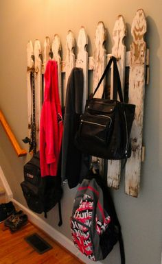 White picket fence underneath the bar in living room for girls bags and jackets