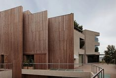 Barcelona-based architects BC Estudio designed a vertical home with a wooden slat facade for a family located in the north of the city.