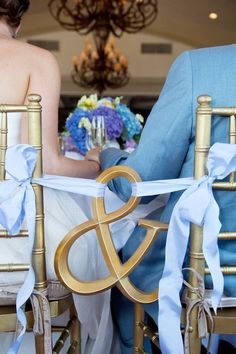 Really cute idea for bride and groom chairs