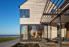 Looking North into the Dining Room Tagged: Exterior, Shed RoofLine, Beach House Building Type, House Building Type, and Wood Siding Material. St Joseph Beachfront Home by Wheeler Kearns Architects. Michigan Lake House, House Design Photos, Dream House Exterior, St Joseph, Modern Exterior, Types Of Houses, Backsplash, Facade, Building A House