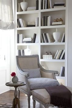 i'd love to have a reading corner, just a cozy small chair and a ridiculous number of books.