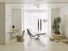 Apartment: Simple Apartment Decoration With Glass Door And Unique Chair With Glass Table And Night Lamp Also Modern Chaise Lounge And White Curtain And Wall Lamp: Pure Simple Apartment Decorating Ideas