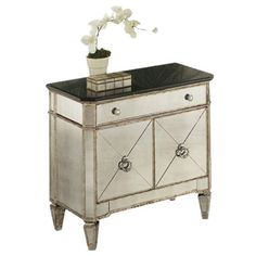Mirrored wood accent chest with kent legs in a distressed finish.     Product: Accent chest    Construction Material: ...