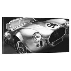 Equally at home in an artful collage or on its own as an eye-catching focal point, this lovely canvas print features a vintage speedster in black and white.