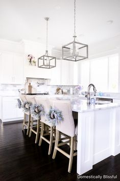 Simple Spring Kitchen Decor to refresh your white kitchen for spring with beautiful faux flowers and spring colors. | Spring decor for your kitchen with pastel colors. | Pastel spring decor for your white kitchen. | White kitchen cabinets, with marble backsplash, and marble counters. | Simple kitchen decor for spring and summer. Australian Home Decor, Australian Interior Design, Australian Homes, White Kitchen Cabinets, Kitchen White, Kitchen Island, Kitchen On A Budget, Kitchen Ideas, Kitchen Designs