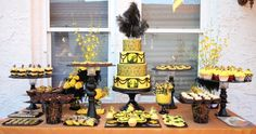 This 1920s theme cake was decorated with edible black lace and edible pictures. Dessert table with cupcakes, cookies, candies, chocolates wa...