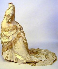A one-piece maternity trained evening gown, circa 1880