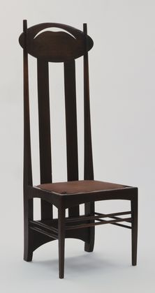 This high-back chair is one of Charles Rennie Mackintosh's best-known designs. The parts are carefully shaped so that they alter in plan or section: most extraordinary are the back legs which are rectangular in plan at the base and then curve and taper upwards until they are circular in plan at the top. An explanation of the chair's appearance and design sources is not simple.