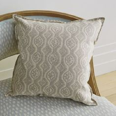 Blithfield -  Peggy Angus Fabric Collection - Pale shades of grey, blue and white making up patterned fabrics for a wooden framed armchair and a square scatter cushion
