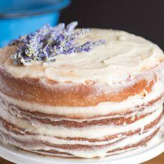 Vanilla Lavender Cake Recipe Afternoon Tea, Desserts with unsalted butter, sugar, eggs, egg whites, vanilla extract, flour, baking powder, dried lavender, salt, buttermilk, white chocolate, sugar, water, dried lavender, unsalted butter, powdered sugar, simple syrup, vanilla extract