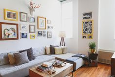 Make an easy gallery wall look pulled together by putting all your random art into coordinating frames.